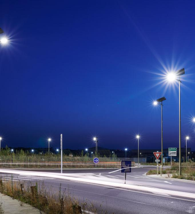 A traffic circle by night lighted with solar-powered energy
