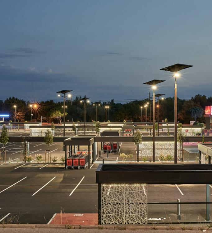 An hypermarket parking lot lighted by Fonroche Lighting's off-grid streetlights