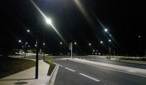 A traffic circle in France by night lighted with solar energy