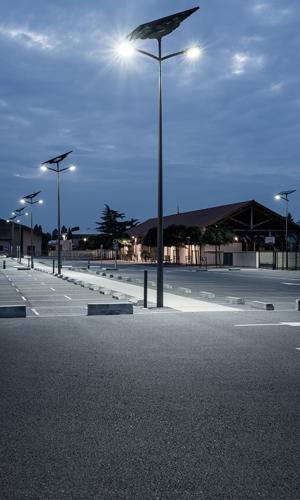 A parking lot by night lighted through solar-powered energy