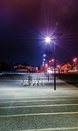 Donnefort city's parc by night lighted by standalone solar street lamps